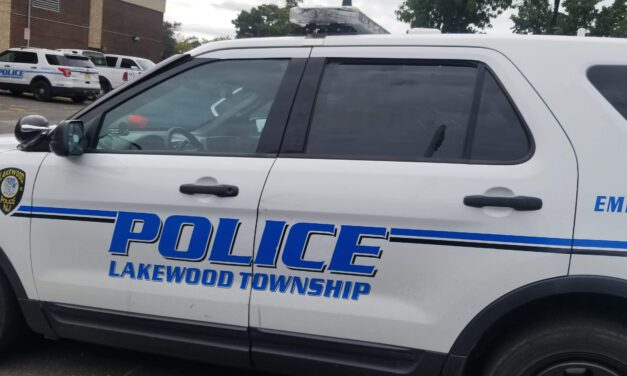 LAKEWOOD: MALE LAYING ON THE GROUND