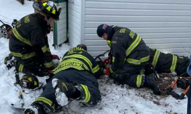 HOWELL: Emergency PErsonnel Save Wedged Dog